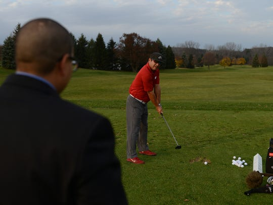 John Teller practices various shots while getting tips