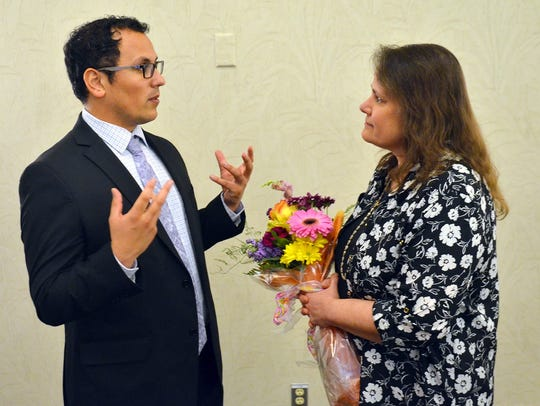 Daniel Gutierrez, who was Springfield's Teacher of the Year for 2017-18, offers to help Jean Lawson moments after she was named the new Teacher of the Year.