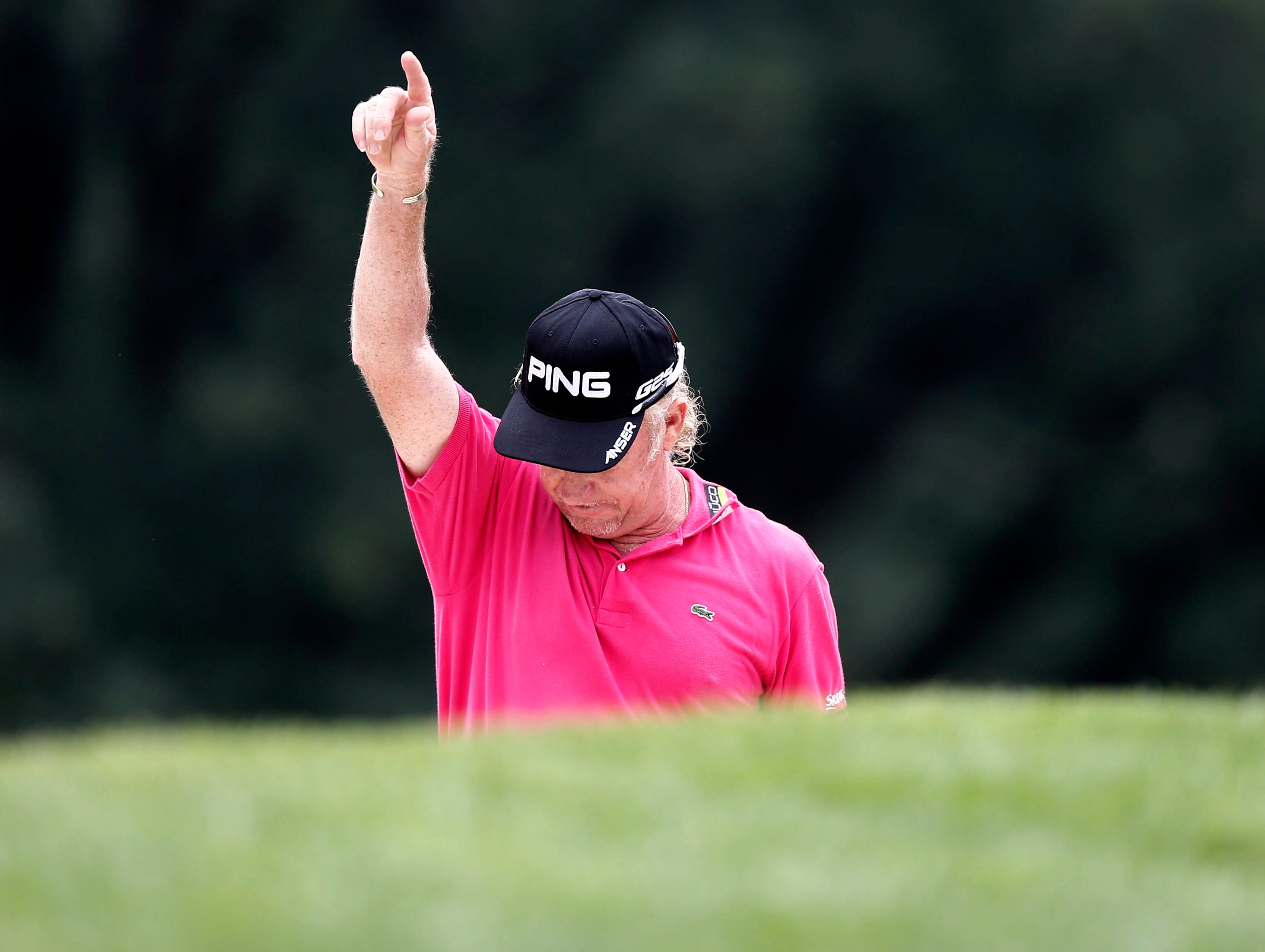 Miguel Angel Jimenez holes outfrom a bunker on the 9th hole.