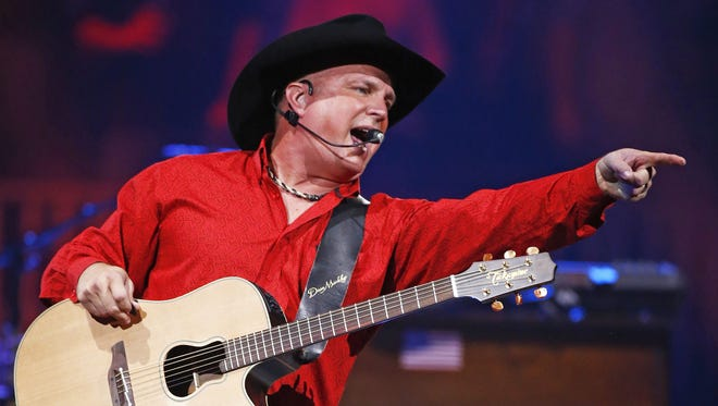 Rob Schumacher/The Republic Country-music legend Garth Brooks performs Friday at Talking Stick Resort Arena in Phoenix. The concert was one of six Brooks is playing at the arena this month ? he?s also doing a show tonight, and two apiece Oct. 23 and 24. Brooks? wife, Trisha Yearwood, also is performing on the tour. Visit music.azcentral.com to see more coverage of Brooks? visit to the Valley. Garth Brooks performs during his world tour on Oct. 16, 2015 at Talking Stick Resort Arena in Phoenix, Ariz.