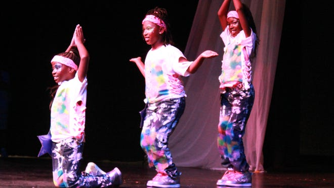 Joycelyn Dunlap, Allison Spivey and Ti'Mia Lawson dance at the 2014 Jackson Idol competition Thursday at the Carl Perkins Civic Center.