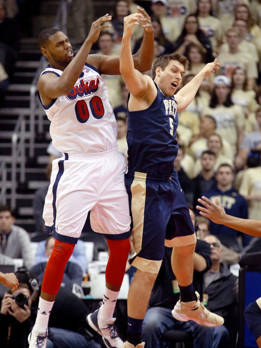 Duquesne's Darius Lewis (00) and Pittsburgh's Rafael Maia (5) collide as they pursue a rebound in the first half of an NCAA college basketball game, Friday, Dec. 4, 2015, in Pittsburgh. (AP Photo/Keith Srakocic)