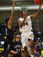 Alamogordo's Amour Elliot, right, attempted a layup Tuesday night. Elliot scored a team-high 17 points.