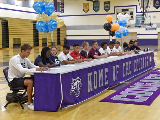 Spanish Springs' Jalen Townsell, who signed to playing basketball at Nevada, and 15 fellow students sign letters to attend colleges during a signing ceremony in the Spanish Springs gym on Wednesday.