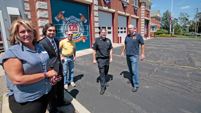 Clarkstown is one of a number of local communities studying whether to set up a 'microgrid' to power key services during disasters. Supporters of the project include Roxy Perrone of the New City Chamber of Commerce; Ariel Laboy, an Orange & Rockland Utilities solar engineer; Chris Jensen, Fire & Emergency Services; police Sgt.  Jim McCormick; and New City Firefighter John McSharar.