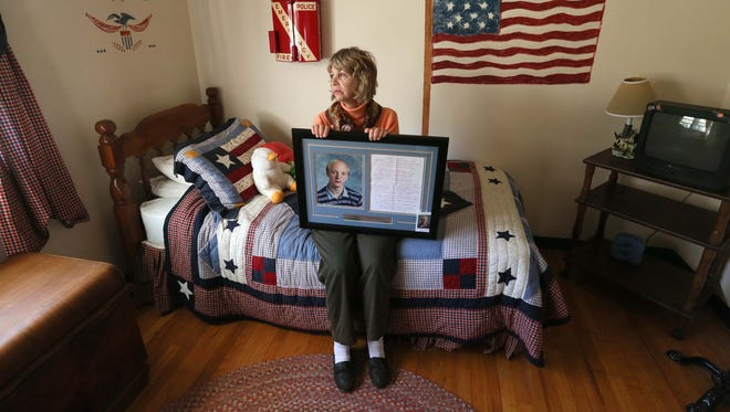 Sue Humphres sits in her 41 year-old autistic son Scott's bedroom who passed away in June. Her son was very aggressive from the condition and Humpheys has been an advocate of medical marijuana to help people with autism.