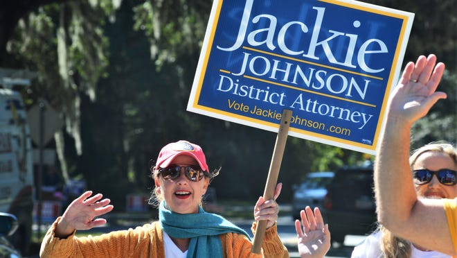 District Attorney Jackie Johnson campaigns for reelection on Tuesday, Nov. 3, 2020, on St. Simons Island, Georgia. Independent challenger Keith Higgins defeated Johnson, a Republican, after she faced criticism for her office's response to the February 2020 killing of Ahmaud Arbery. The 25-year-old Black man was fatally shot by a white father and son who saw him running in their neighborhood. More than two months passed before they were charged in the case.