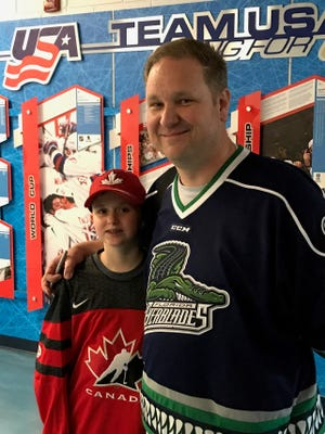 Brian Evans and his son Tyler, of Macomb Twp., happily made the hour-long drive to USA Hockey Arena for Tuesday's doubleheader.