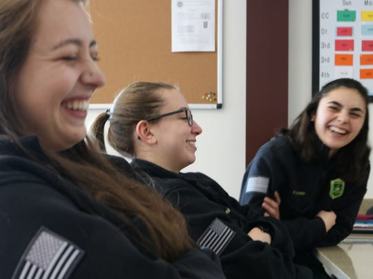 UVM Rescue squad volunteer EMT Amanda Locke center with Cami Pontarelli, left, and Elena Sayers, right, have a laugh at each others stories of life on the emergency crew on Dec. 29, 2017.