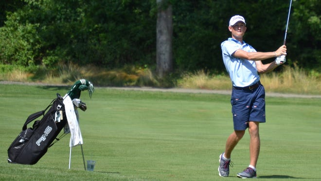 Christian Cavaliere follows the flight of his approach on the 15th hole at The Patterson Club Wednesday in a Met Junior quarterfinal match.