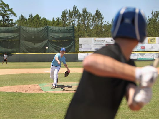 Leon's Zack Treadway tosses BP to high school teammate and summer league teammate Russell Rauh as part of Tallahassee Post 13's practice at Chiles. Post 13 is gunning for back-to-back state titles.