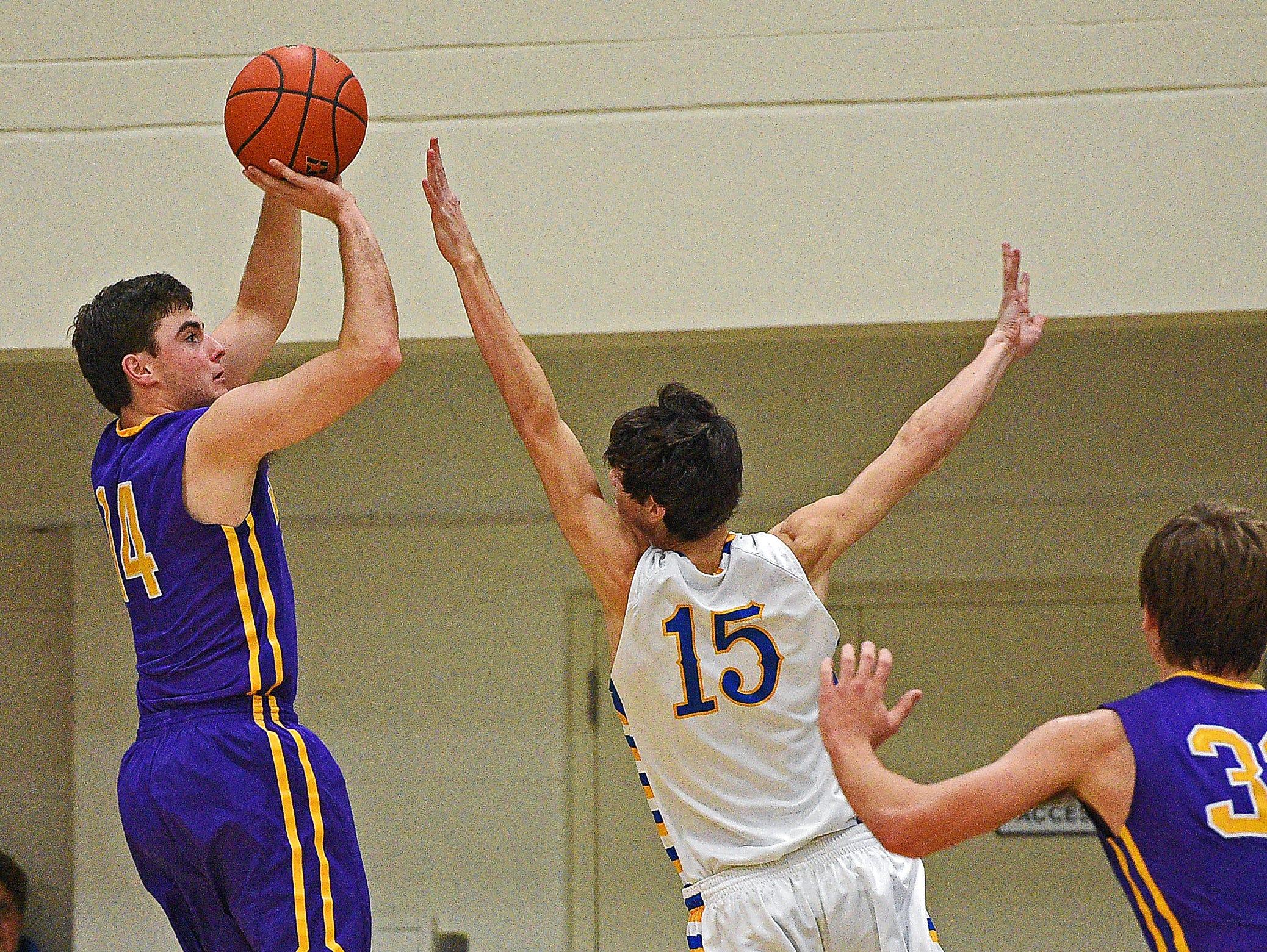 Watertown's Alex Gauer (14) takes a shot over O'Gorman's Joey Messler (15) during a game Thursday, Dec. 15, 2016, at O'Gorman High School in Sioux Falls.