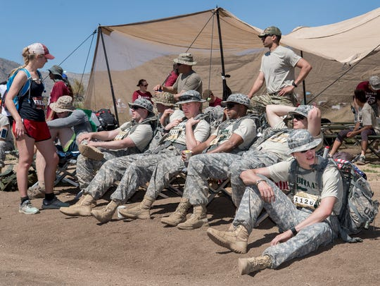 Jacob Angevine, right, and his ROTC group take a breather