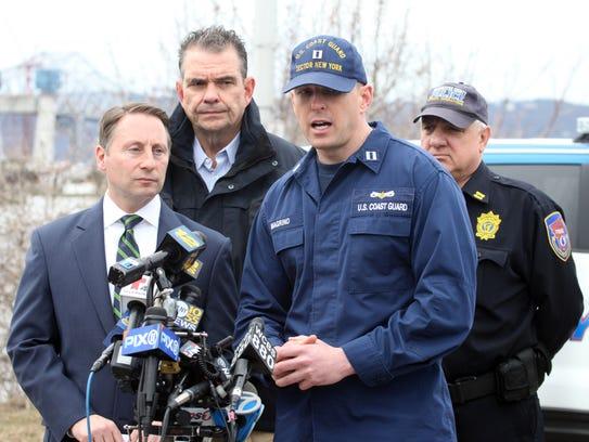 U.S. Coast Guard Lt. Mark Magrino, speaks to the media