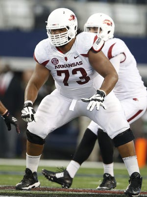 While there's still a lot of Sebastian Tretola to go around at 325 pounds, Arkansas' starting left guard is 50 pounds lighter than last August and in a much better state conditioning wise.