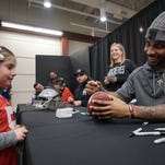 An overflow crowd lined up at the Richland Mall on Saturday for autographs from former Ohio State football players Braxton Miller, Joel Hale and Tommy Schutt.