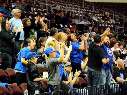 Carlsbad fans cheer during the final minute of regulation on Tuesday.