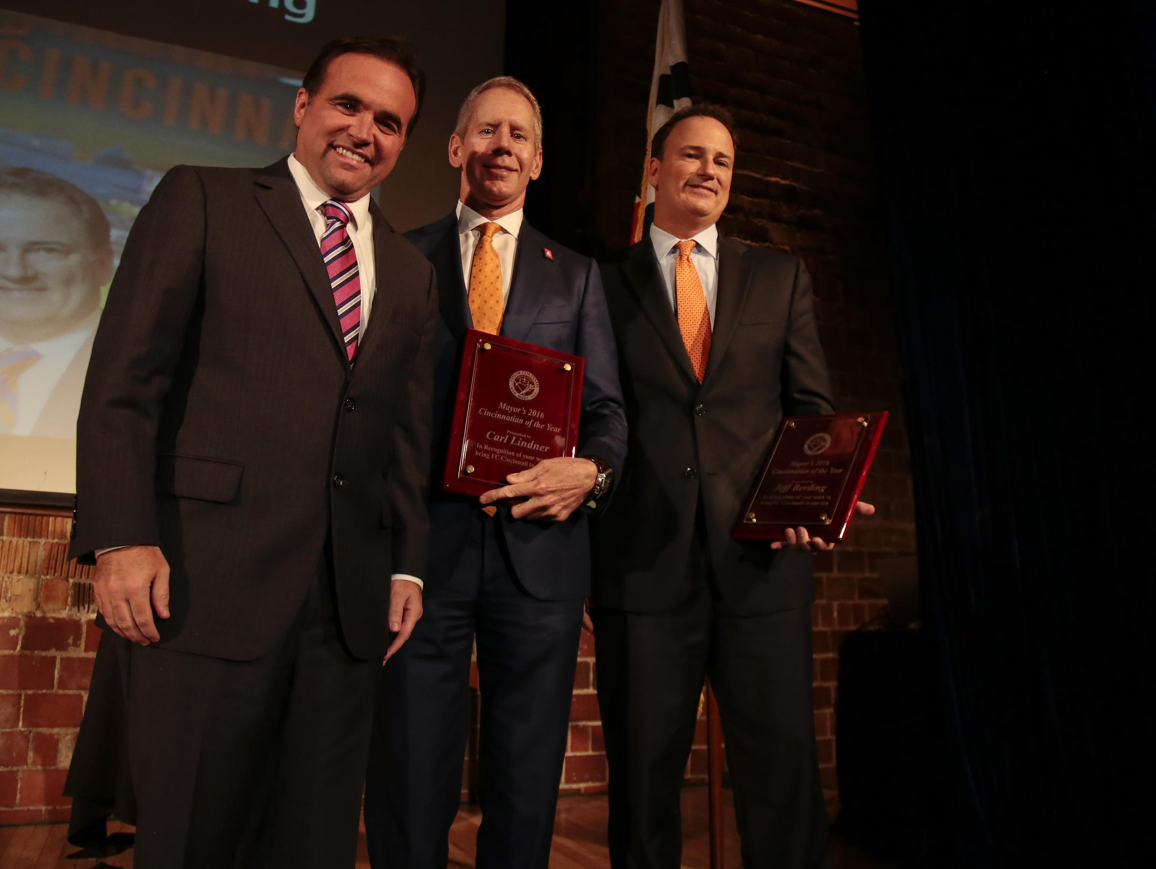 FC Cincinnati CEO Carl H. Lindner III, center, and President & General Manager Jeff Berding, right, have declined to talk about financial details of landing an MLS soccer team. They are shown here with Cincinnati Mayor John Cranley in 2016.