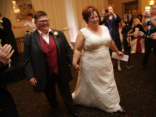 April DeBoer and Jayne Rowse legally marry at a banquet