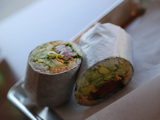 A spicy tuna sushi burrito from Yuzu Sushi Co. in Royal