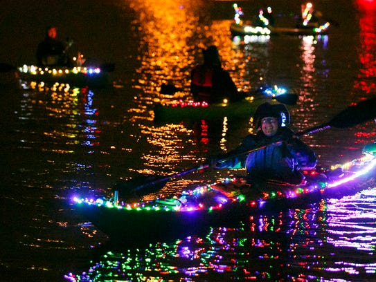 Kayakers paddle around the Willamette River by Riverfront Park at last year's Illuminata Regatta. This year's event will be Dec. 16.