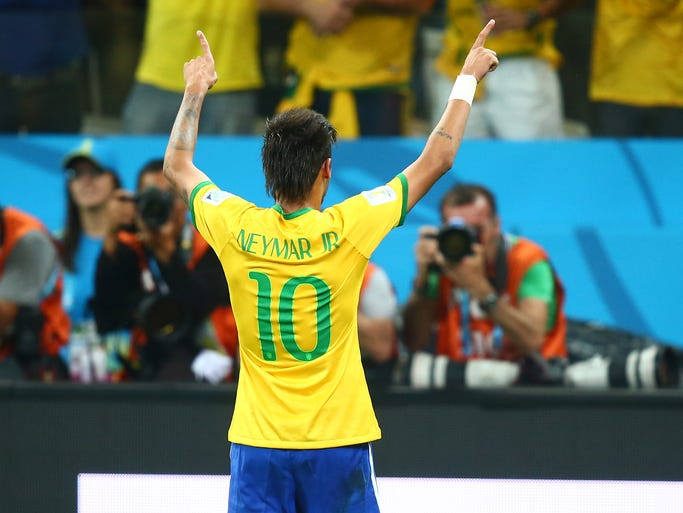 Neymar celebrates his second goal of the game.