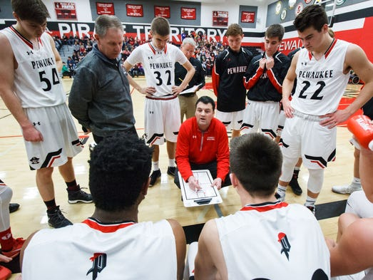 Pewaukee head coach Michael Basile talks with players