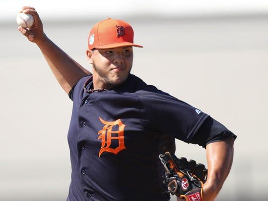 Detroit Tigers pitcher Joe Jimenez throws during spring