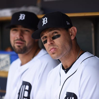 Nick Castellanos, left, is staying with the Tigers