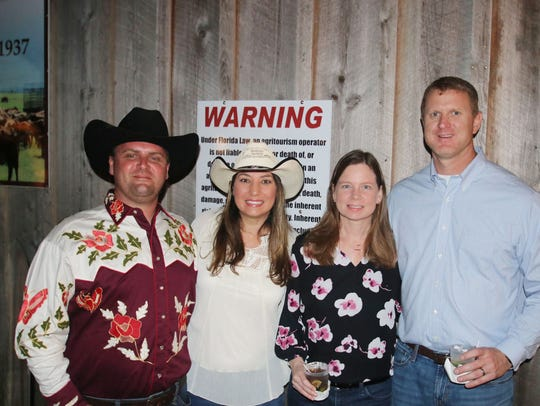 Shawn and Roxanne Peters, left, with Tracy and Jarrod