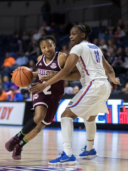 Mississippi State guard Morgan William (2) drives past Florida guard Dyandria Anderson (11) during the second half of an NCAA college basketball game in Gainesville, Fla., Thursday, Feb. 8, 2018. (AP Photo/Ron Irby)