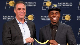 Indiana Pacers first-round pick Aaron Holiday is introduced to the media by Pacers president of basketball operations Kevin Pritchard, left, at Bankers Life Fieldhouse on Friday, June 22, 2018.