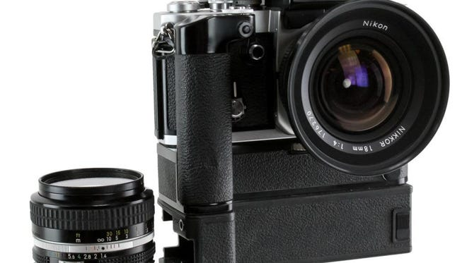Vintage cameras are hitting the secondary market. This Nikon AS camera with case and accessories recently sold at auction for $550.