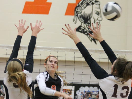 Anderson's Olivia Schwamberger hits over the Turpin blockers.