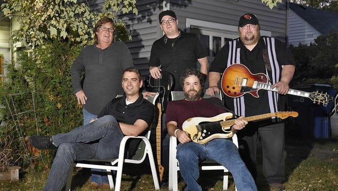 Allman Joy band members, from left, Greg Jorgenson, Karl Konz, Andy Ferkinhoff, Mark Hasbrouck and Harry Kent take a break during practice Oct. 6.