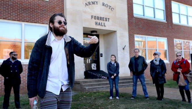 Dalton Winfree, left, an MTSU senior speaks out about Forrest Hall being named after Nathan Bedford Forrest, as part of a rally where protesters marched through campus and performed a mock burial of an effigy of Nathan Bedford Forrest on the steps of Forrest Hall, on Monday, Nov. 23, 2015.