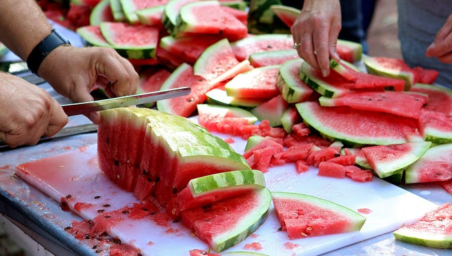 Over 80 watermelons were sliced and given away as part of Watermelon Fest Saturday morning at the Downtown Wichita Falls Farmers Market.