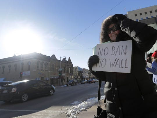 Jane Keggi of Appleton  joins protesters gathered Thursday in downtown Appleton.