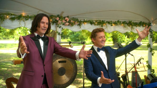 """Keanu Reeves, left, and Alex Winter reprise their classic roles in """"Bill & Ted Face the Music."""""""