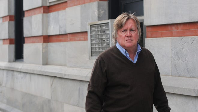 """Fred Knapp, seen approaching Dutchess County Court in this file photo, was included in a """"temporary release"""" program and transferred to a medium-security prison."""