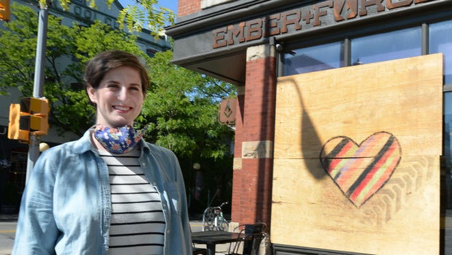 Hannah Kirby's Ember + Forge coffee shop reopened shortly after vandalism that occurred during the May 30 rioting in downtown Erie.
