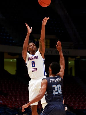 Louisiana Tech Bulldogs guard Alex Hamilton (0) shoots over Old Dominion Monarchs guard Trey Freeman (20)  at Legacy Arena.