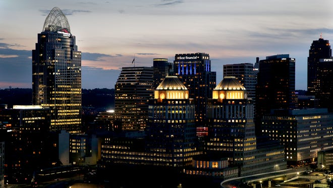 The sunsets over the Cincinnati skyline, seen from Mt. Adams Wednesday October 5, 2017. Great American Tower at Queen City Square, left, and P & G headquarters.