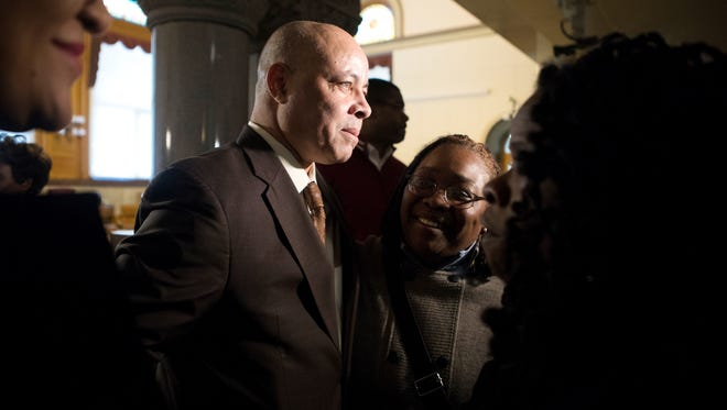Cincinnati City Manager Harry Black talks with supporters Pastor Lesley Jones (center) and Iris Roley on Wednesday after the council meeting at city hall. The Enquirer/Carrie Cochran