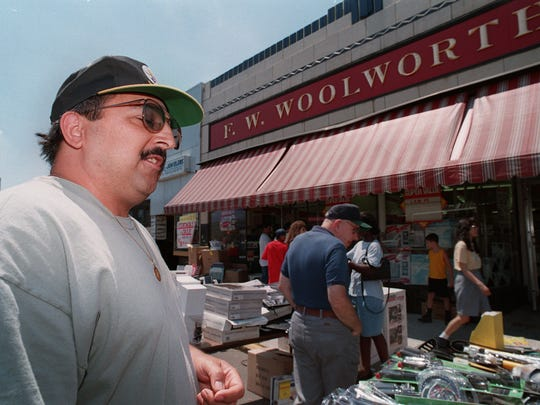 Joe Gentile of Bergenfield outside the borough's Woolworth store in 1997. He recalled playing stickball behind the Woolworth in West New York when he was a boy. If he or one of his friends broke a game ball, one of them would go into the store and buy a new one.