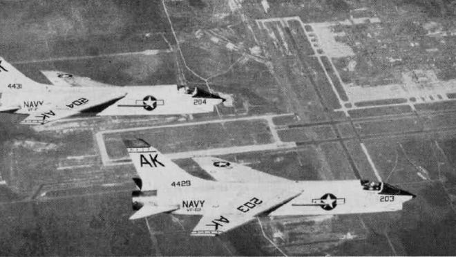 U.S. Navy F8U-1 Crusader fighters from Fighter Squadron VF-62 Boomerangs, Carrier Air Group 10 (CVG-10), over NAS Cecil Field, FL. PHOTO: U.S. Navy Naval Aviation News, August 1962.