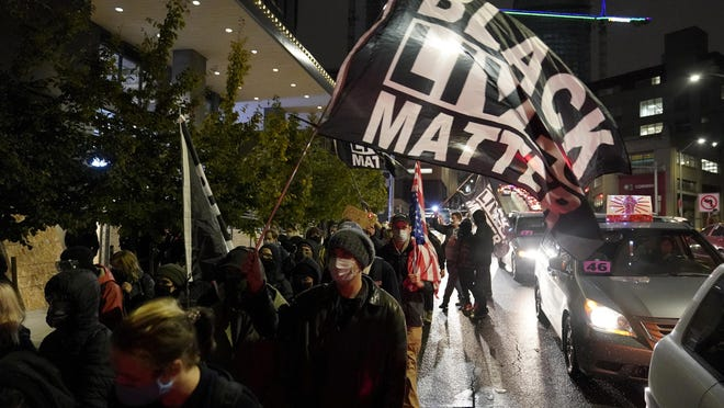 People march on the night of the election in Seattle, Tuesday, Nov. 3, 2020.