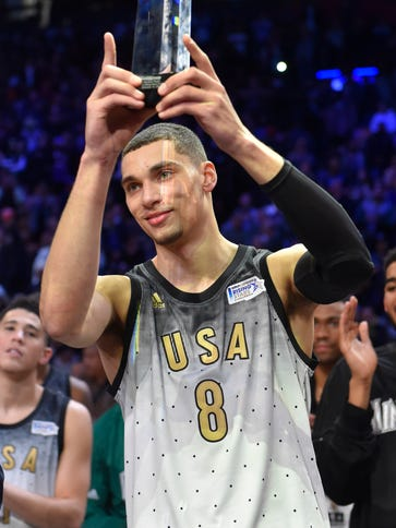 Zach LaVine holds up his trophy after being announced