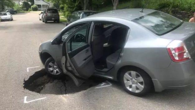 The sinkhole opened on a residential street in Cincinnati's Northside neighborhood