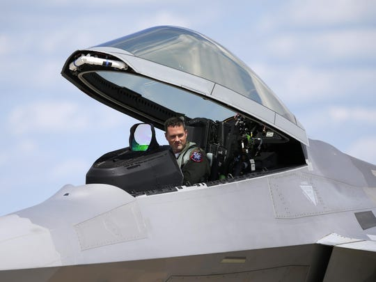 F-22 Raptor pilot Maj. John Cummings waits before exiting his jet Tuesday during the EAA AirVenture 2015 Airshow at Wittman Regional Airport.